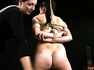 Tied and gagged naked girl bent and pleasured by mistress