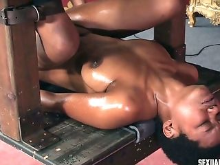 Wicked mistress fucks her slave with her strap on dildo until she is all wet