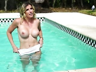 Attractive big tittied milf Cory Chase gives a blowjob by the poolside and gets laid