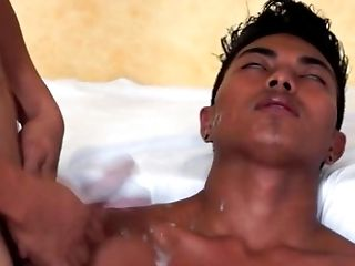 Asian MD giving facial treatment to twink