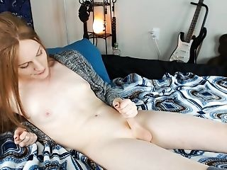 Redhead cums, deepthroats, and plays with buttplug in socks