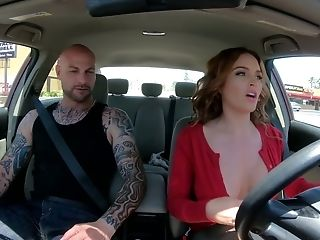 Bitchy milf Krissy Lynn picks up one tattooed hunk and gives him a blowjob in the car