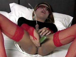 Hot ladyboy inserts thick cucumber in the ass and sucks cock