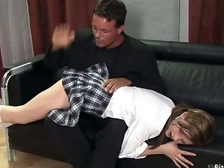 Cute pigtailed college chick Tarra gets spanked and fucked by angry stepdad
