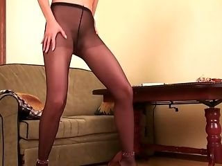 Long legged skinny blondie looks so seductive in black pantyhose