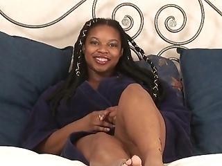 Busty ebony BBW rubs her hairless pussy