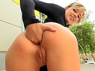 Solo model in a black shirt decides to push the fingers into her anus