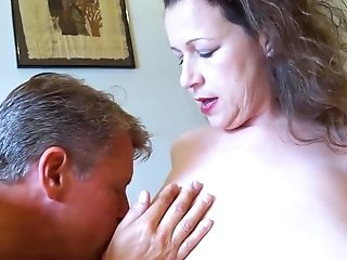 Horny mature lady seducing and playing with handy businessman